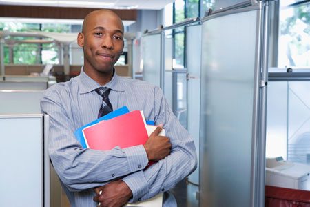 Young, male paralegal with files